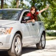 Happy woman in car — Stock Photo #11926818