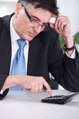 Worried businessman calculating — Stock Photo