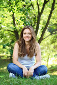 Beautiful woman resting in park — Stock Photo