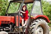 Woman on tractor — Stock Photo