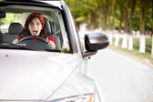 Scared woman behind the wheel — Stock Photo