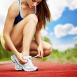 Athlete girl trying shoes - Stock Photo