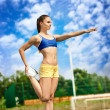 Athletic woman starching - Stock Photo