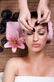 Beauty woman having cosmetic massage,facial treatment — Stock Photo