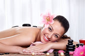 Hot stone massage in the day spa — Stock Photo