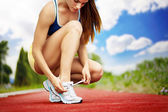 Athlete girl trying shoes — Stock Photo