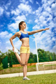 Athletic woman starching — Stock Photo