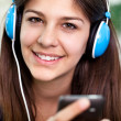 Pretty young woman using mobile phone — Stock Photo #11970360