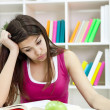 Teenage girl studying at the desk being tired — Stock Photo