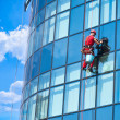 Window washer building windows from outside — Stock Photo #11970427