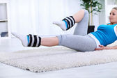 Woman doing exercise for strengthening legs — Stock Photo