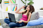 Young girl using modern technology — Stock Photo