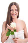 Spa woman with rosebud — Stock Photo