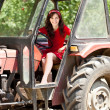 Stock Photo: Girl in tractor