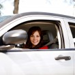 Smiling woman driving her modern car — Stock Photo