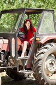 Girl in tractor — Stock Photo