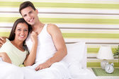 Romantic young couple in bed — Stock Photo