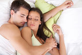 Lovely young couple sleeping — Stock Photo