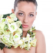 Beautiful woman with flower — Stock Photo