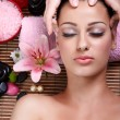 Hands massaging female face at the spa — Stock Photo
