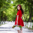 Girl with basket of flower — Stock Photo