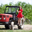 Country girl on tractor — Stock Photo