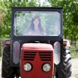 Woman driving tractor - Foto Stock