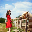Cute girl with horse - Photo