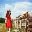 Stock Photo: Cute girl with horse