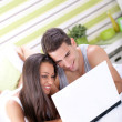 Cheerful couple using a computer — Stock Photo