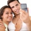 Affectionate couple take photo by mobile phone — Stock Photo