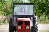 Woman driving tractor — Stock Photo