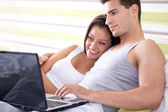 Young couple browsing the internet — Stock Photo