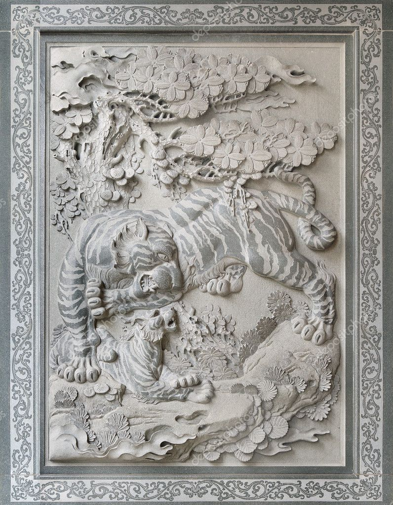 Tiger with cub chinese temple wall stone sculpture — stock