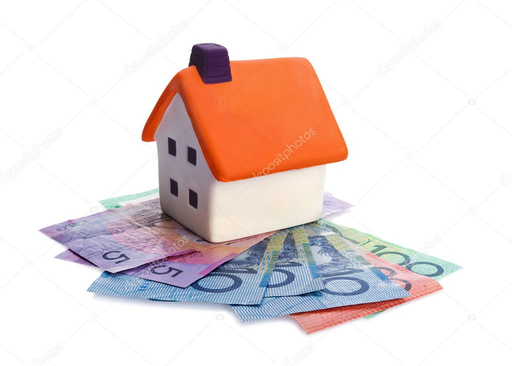 Real estate concept - house and money on white background — Stock Photo #11233497
