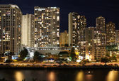 Skyscrapers and partial skyline of Honolulu, Hawaii, at night — Stock Photo