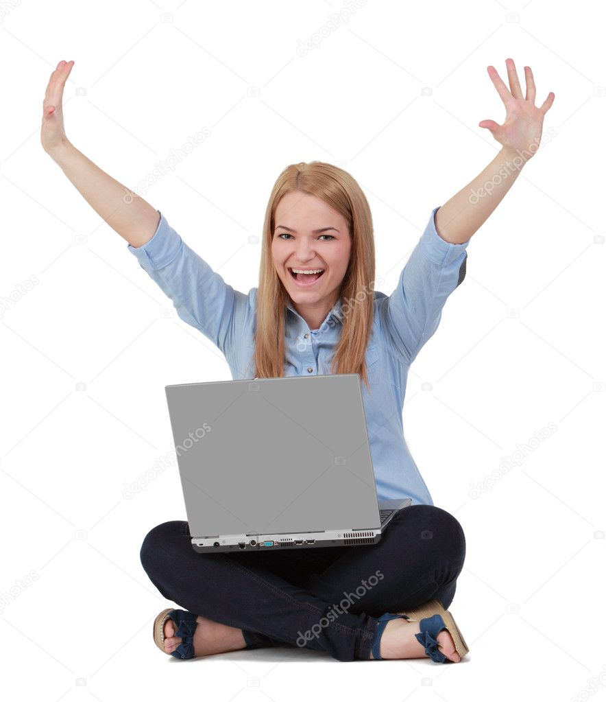 Happy young blonde woman raising hands while sitting with a laptop in her lap. — Stock Photo #10797909