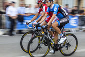 Saint Quentin, France, July 5th 2011:Panning image of two cyclists from Garmin-Sharp team and Katusha Team — Stock Photo