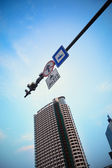 Traffic camera with telltale sign and prohibit sign under blue s — Stock Photo