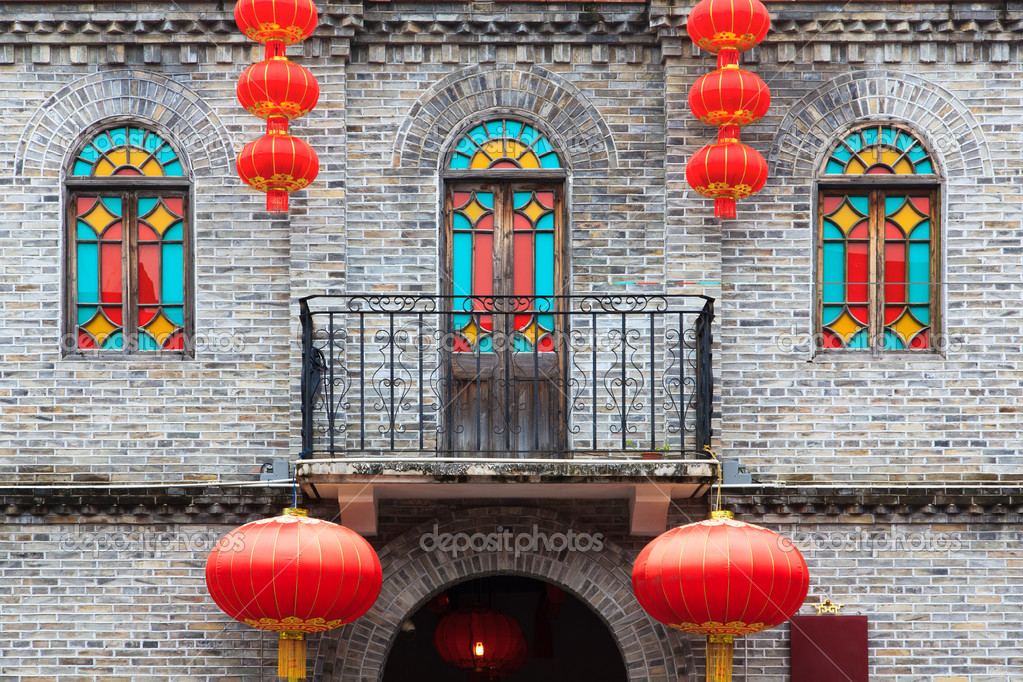 Detail of Chinese old style building facade with colorful windows and hanging lanterns as an ornament.This is architectural style in the begin of last century's. — Stock Photo #11188824