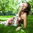 Beautiful woman is lying on the grass — Stock Photo #10818267