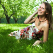 Beautiful woman is lying on the grass — Stock Photo #10818282