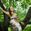 Beautiful girl laughing in apple orchard — Stock Photo #10818315