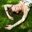 Smiling woman relaxes on the grass — Stock Photo #11152742