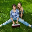 Two attractive girls with a laptop in the park — Stock Photo #11152890