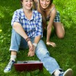 Two attractive girls with a laptop in the park — Stock Photo #11152899
