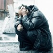 Homeless alcoholic in depression - Stock Photo