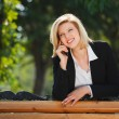 Businesswoman calling on the phone — Stock Photo