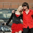 Young couple with a convertible car - Foto Stock