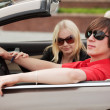 Young couple in a convertible car - Foto Stock